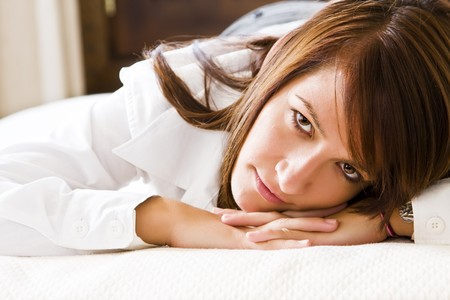 Businesswoman posing over white sheets photo