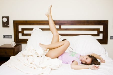 Young beautiful woman enjoying her waking up. photo
