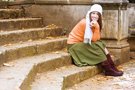 Young happy woman wearing winter clothing.