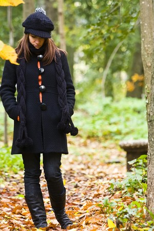 Thoughtful woman walking in the woods photo