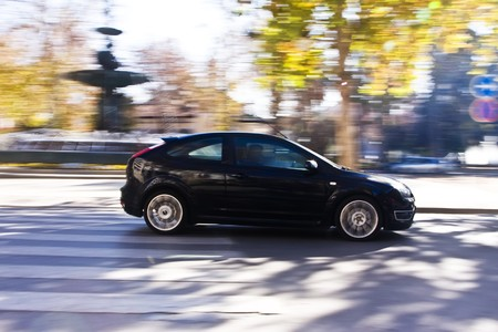 faster: Black vehicle at high speed in urban background
