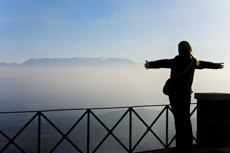 oneness: Young woman feeling freedom in the top of the world Stock Photo