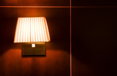 Vintage lamp on red wall. photo