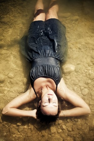 woman floating: Young woman relaxing in the water Stock Photo