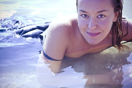 Sensual young blonde in the water. photo