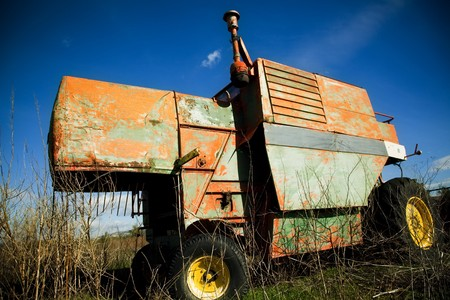 yard stick: Disused old machinery under ble sky. Stock Photo