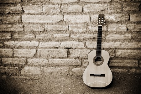 spanish guitar: Classic guitar over old brickwall