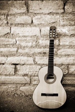 brickwall: Classic guitar over old brickwall