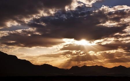lightbeam: Lower sun covered by dark clouds