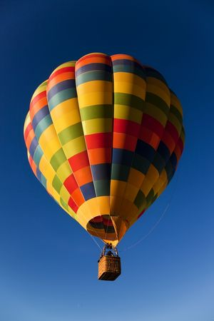 unrecognizable people: Unrecognizable people traveling in a multicolor balloon