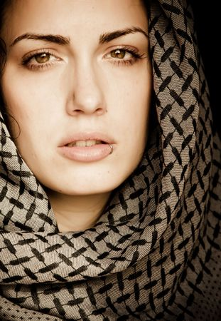 Arab woman using veil with her mouth pierced. Stock Photo - 4625072