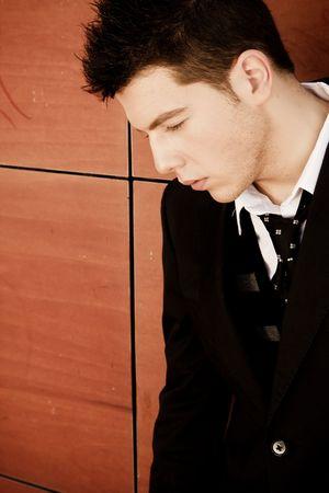 Young pensive businessman close portrait photo