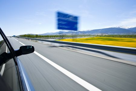 Driving at high speed under blue sky. Stock Photo