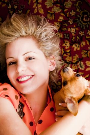 Young blond beauty posing with her pet. Stock Photo - 4747749