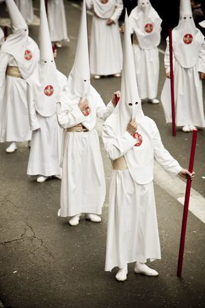 Believers in a procession over the streets. Stock Photo