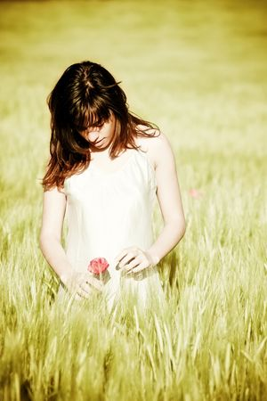 Sweet young girl holding a flower photo
