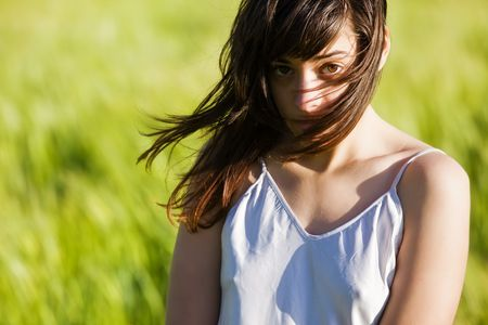 Sweet young woman on green meadow. Stock Photo - 4983026