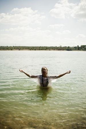 Young blond woman meditating in the water. photo