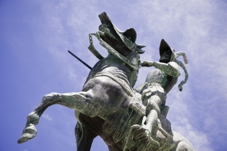 conqueror: Pizarro statue over the blue sky. Stock Photo