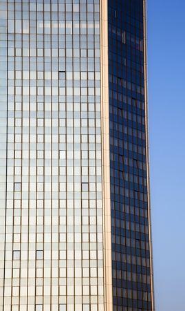 Blue skyscraper facade over clear sky. photo