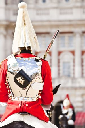 Two horse guards in front each other. photo