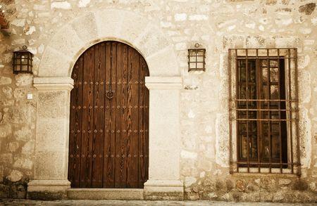 Rustic house facade, wooden door. Stock Photo - 5349489