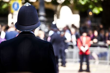 Metro policeman and queen´s guard face off Stock Photo - 5349461