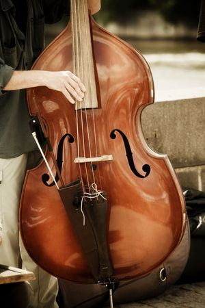 Street artist performing double bass photo