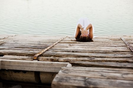 Young desperate woman over wooden surface photo
