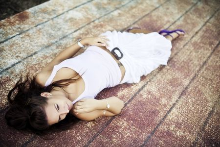 Young woman laying over rusty surface. Stock Photo - 5594859