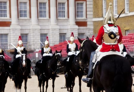 Horse guards in front each others. photo