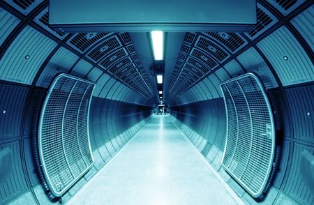 futuristic interior: Cylindric tunnel for pedestrians, blue toned.