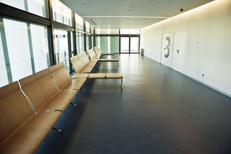 Minimalist waiting room with a big number 3