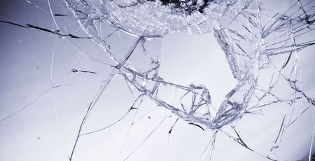 cracked glass: Broken glass in clear blue tone. Stock Photo