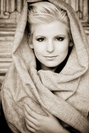 Young beauty wearing arab veil, sepia toned. photo