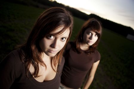 Young female teenagers posing at dawn photo