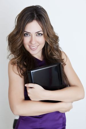 Young beautiful woman holding black mini-laptop photo