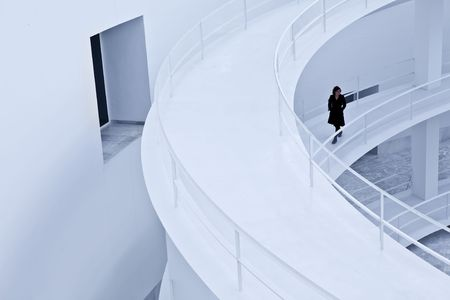 Woman in black walking over an abstract corridor photo