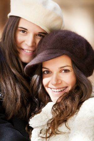 Two female friends staring at camera photo