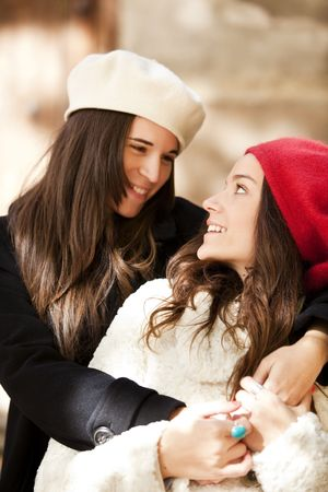 Two female friends staring at each other. focus on the right girl. photo
