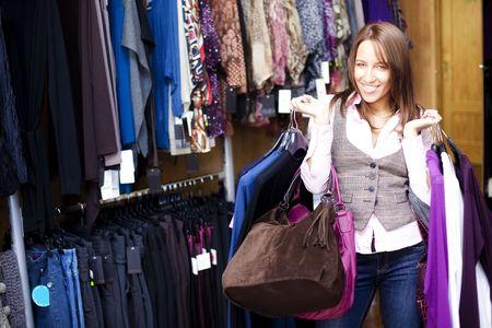 Young beautiful woman in a fashion shop photo