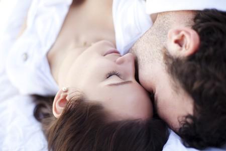 Young beautiful loving couple close portrait. Фото со стока