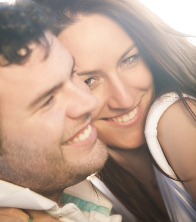 Closeup on young beautiful smiling couple. Stock Photo - 6965863