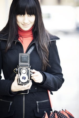 Young female photographer using old 6x6 camera. photo