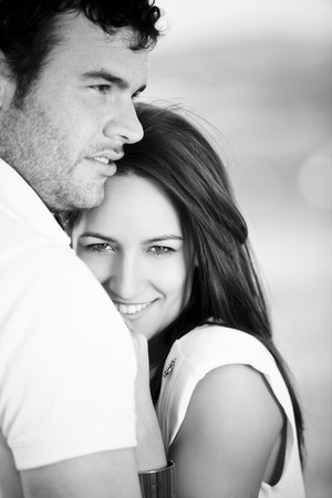 Closeup on young beautiful smiling couple. Stock Photo - 6965884