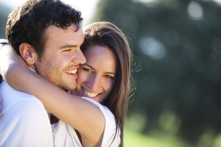 sexy couple embrace: Closeup on young beautiful smiling couple.
