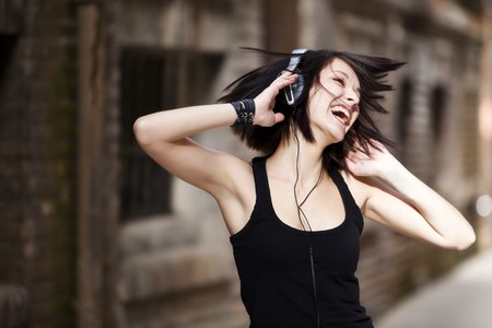 headphone: Young beautiful girl happy and dancing Stock Photo
