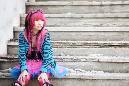 Young asian sad girl with cosplay looking. photo