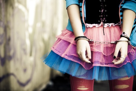 Handcuffs on young girl in modern dressing Stock Photo - 6987729