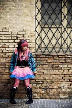 Teen wearing doll fashion style on brickwall photo